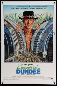 2085UF CROCODILE DUNDEE 1sh '86 cool art of Paul Hogan looming over New York City by Daniel Goozee!