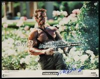 6f012 COMMANDO color signed 11x14 still #7 '85 by Arnold Schwarzenegger, close up with assault rifle