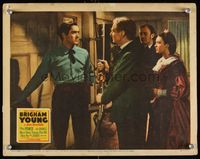 6f343 BRIGHAM YOUNG LC '40 Tyrone Power with rifle at door, Dean Jagger, Linda Darnell