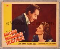 6f347 BULLDOG DRUMMOND'S SECRET POLICE LC '39 c/u of John Howard smiling down at Heather Angel!