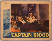 6f356 CAPTAIN BLOOD LC '35 smiling Errol Flynn firing pistol laying on bed, Basil Rathbone