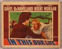 6f001 IN THIS OUR LIFE signed LC '42 by Bette Davis, who is close up in bed by Olivia De Havilland!