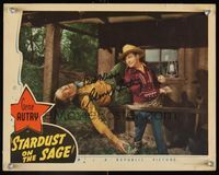 6f036 STARDUST ON THE SAGE signed LC '42 by Gene Autry, who's close up punching bad guy over rail!