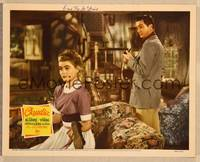 1d009 CLAUDIA signed LC '43 by pretty Dorothy McGuire, who's shining Robert Young's shoes!