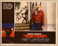 1d022 EYE FOR AN EYE signed LC #6 '81 by Chuck Norris, who's close up in really outdated jacket!