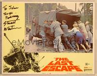 1d031 LAST ESCAPE signed LC #2 '70 by Stuart Whitman, who's helping people push truck out of mud!