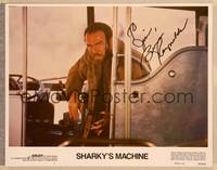 1d048 SHARKY'S MACHINE signed LC #1 '81 by Burt Reynolds, who's close up in bus holding gun!