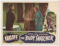 3a262 BODY SNATCHER LC '45 full-length Boris Karloff holding top hat stares down Henry Daniell!