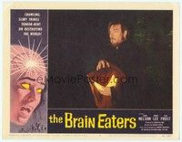 3a290 BRAIN EATERS LC #8 '58 close up of man holding glowing brain concealed under cloth!