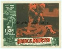 3a257 BRIDE OF THE MONSTER LC #3 '56 Ed Wood, Tor Johnson stands over beaten opponent in lab!