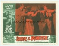 3a254 BRIDE OF THE MONSTER LC #6 '56 Ed Wood, Bela Lugosi & girl standing by guy chained to wall!