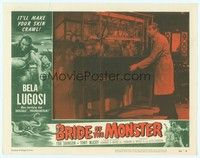 3a253 BRIDE OF THE MONSTER LC #8 '56 Ed Wood, full-length Bela Lugosi stands in front of equipment!