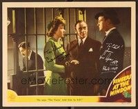 5g036 FINGERS AT THE WINDOW signed LC '42 by Laraine Day AND Lew Ayres, standing outside jail cell!