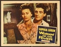 5g080 WOMAN OF THE RIVER signed LC #8 '57 by Sophia Loren, who's in close up looking at a picture!