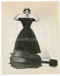 7b007 AUDREY HEPBURN 8x10 still '57 full-length standing over cello from Love in the Afternoon!
