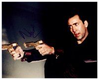 8s085 NICHOLAS CAGE signed color 8x10 REPRO still '00s cool c/u poitning two guns from Face/Off!