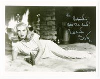 9a076 LIZABETH SCOTT signed 8x10 REPRO still '80s full-length laying on fur rug by fireplace!