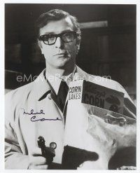 9a078 MICHAEL CAINE signed 8x10 REPRO still '80s great c/u with gun & Corn Flakes from Ipcress File!