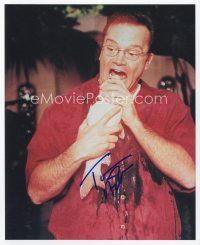 9a093 TOM ARNOLD signed color 8x10 REPRO still '02 wacky c/u putting a whole fish in his mouth!