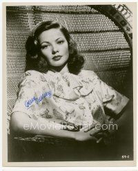 9a058 GENE TIERNEY signed 8x10 REPRO still '80s seated portrait in large wicker chair!