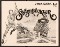 9g375 SWASHBUCKLER pressbook '76 art of pirate Robert Shaw swinging on rope by ship!