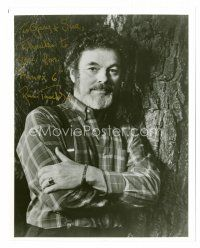 9k093 RUSS TAMBLYN signed 8x10 REPRO still '92 close up posing by a tree with his arms crossed!