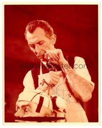 9z277 PETER CUSHING signed color 8x10 REPRO still '70s as Dr. Frankenstein drilling into guy's head!