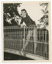 1m005 AUDREY HEPBURN 8.25x10 still '56 full-length with pigtails leaning over rail on bridge!