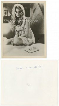 2a079 BRIGITTE BARDOT 8x10 still '59 seated on bed looking at mirror from A Woman Like Satan!