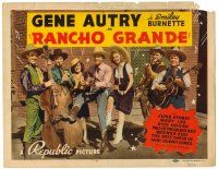 3h065 RANCHO GRANDE TC '40 Gene Autry playing guitar with band, pretty June Storey!