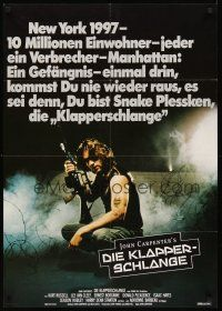 4b072 ESCAPE FROM NEW YORK German '81 John Carpenter, cool image of Kurt Russell w/rifle!