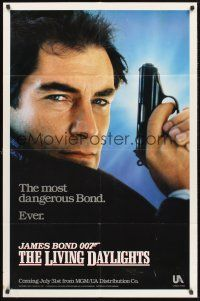 4g564 LIVING DAYLIGHTS teaser 1sh '87 super close up of Timothy Dalton as James Bond with gun!