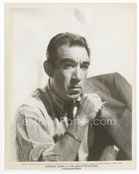 4h068 ANTHONY QUINN 8x10.25 still '57 great head & shoulders portrait smoking a cigarette!