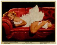 6r017 PRINCE & THE SHOWGIRL color 8x10 still #8 '57 sexy Marilyn Monroe smiling on couch in feathers