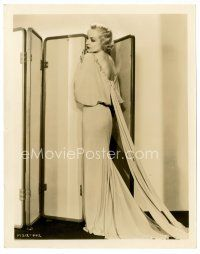 6w047 CAROLE LOMBARD 8x10 still '30s full-length standing in front of screen in sexiest gown!