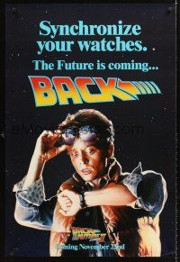 7c029 BACK TO THE FUTURE II teaser DS 1sh '89 art of Michael J. Fox, synchronize your watch!