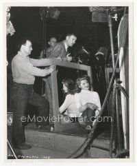 7w069 COVER GIRL candid 8x10 still '44 sexy Rita Hayworth relaxing on set waiting for next scene!