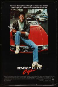 8e072 BEVERLY HILLS COP 1sh '84 great image of cop Eddie Murphy sitting on Mercedes!