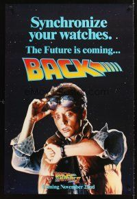 9k071 BACK TO THE FUTURE II teaser DS 1sh '89 art of Michael J. Fox, synchronize your watch!