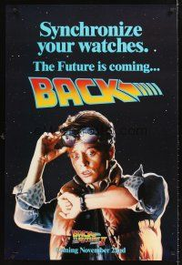 2c055 BACK TO THE FUTURE II teaser DS 1sh '89 art of Michael J. Fox, synchronize your watch!