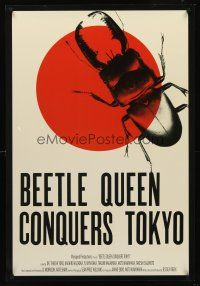 2c076 BEETLE QUEEN CONQUERS TOKYO 1sh '09 cool art of big bug over rising sun!
