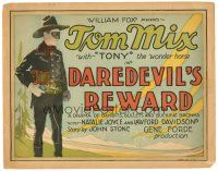 3e043 DAREDEVIL'S REWARD TC '28 great image of masked cowboy Tom Mix pointing his gun!