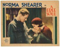 3e022 FREE SOUL LC '31 Leslie Howard stares at pretty Norma Shearer, who is kissing his hand!