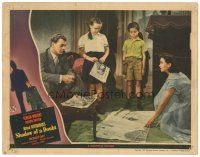 3e016 SHADOW OF A DOUBT LC '43 Joseph Cotten watches Teresa Wright spread newspapers on floor!