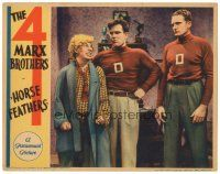 3m494 HORSE FEATHERS LC '32 Harpo Marx makes his meanest face at two huge football players!
