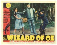 9f095 WIZARD OF OZ LC '39 Judy Garland & Ray Bolger help leaning Jack Haley, and Toto too!