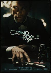 3f140 CASINO ROYALE teaser 1sh '06 Craig as James Bond sitting at poker table w/gun!