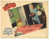 3w227 BLOB LC #6 '58 woman on bed watches old man in pajamas take out Civil Defense helmet!
