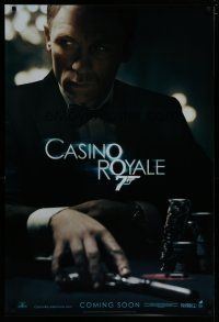 7d425 CASINO ROYALE int'l teaser DS 1sh '06 Craig as James Bond sitting at poker table w/gun!