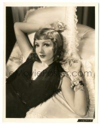 8h210 CLAUDETTE COLBERT 8x10.25 still '33 on pillows in silk dress & bracelets from Tonight Is Ours!